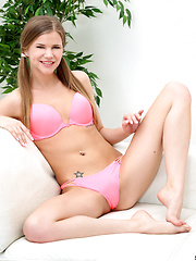 Naughty nubile shows off her hot pink panties - Erotic and nude pussy pics at GirlSoftcore.com