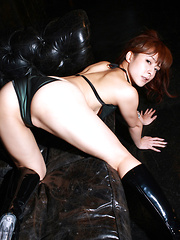 Rika Kawamura Asian in boots shows naughty behind in nylon outfit - Erotic and nude pussy pics at GirlSoftcore.com
