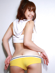 Rika Kawamura Asian shows ass and love box in yellow shorts - Erotic and nude pussy pics at GirlSoftcore.com